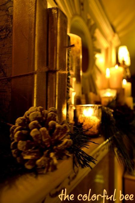 mantel with pinecones, books and candles