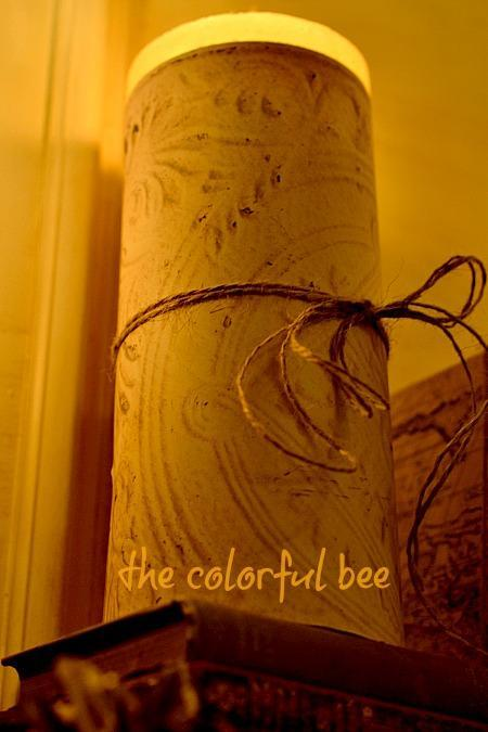 candle covered with faux tin ceiling paper and twine