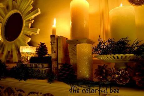 fireplace mantel with candles, books and mirror