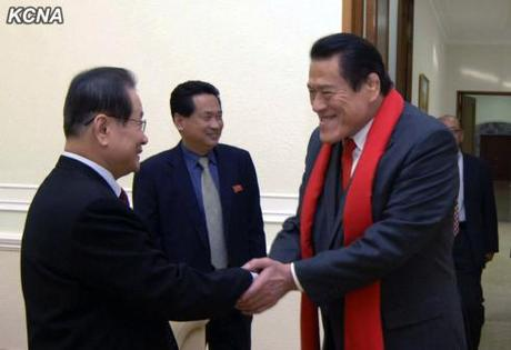 Antonio Inoki (R) shakes hands with KWP Secretary and Director of International Affairs Kim Yong Il (L) on 15 January 2-13 (Photo: KCNA).