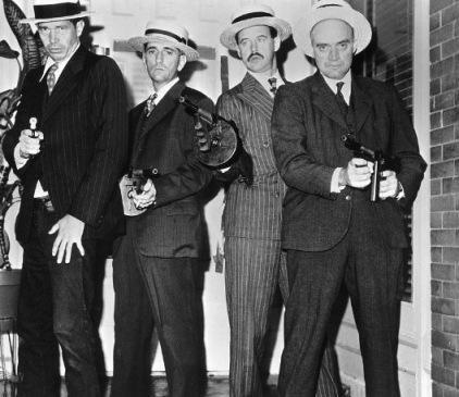 The Dillinger Gang: Dillinger, Van Meter, Pierpont, and Makley. Is Dillinger wearing jeans here, or am I crazy?
