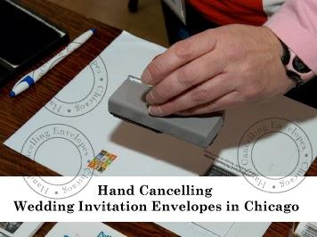 Hand Cancelling Wedding Invitation Envelopes in Chicago