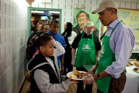 President Obama serves food in a soup kitchen on MLK Day of Service, 2010.