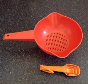 Riccarton Rotary Sunday market Retro vintage thrifted op shop finds Tupperware measuring spoons orange colander