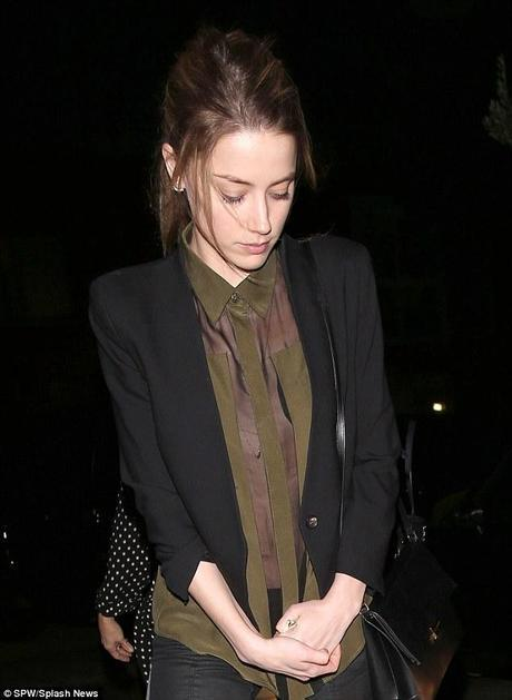 Backtracking: Upon leaving the restaurant several hours later, the actress went to great lengths to cover her left hand as she waited for her car to be brought around by the valet