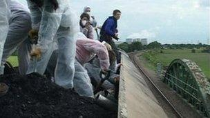 During the protest coal was shovelled on to the track to stop the train moving.