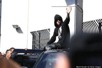 Justin Bieber Riding Away From The Police Station On Top Of His Escalade After His Arrest Is BAWSE.
