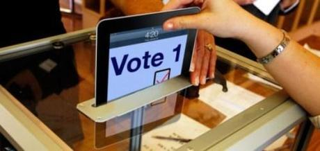 In largely unreported text, President Obama's special commission on election reform recommended tablet computers, such as iPads, be used to cast votes.