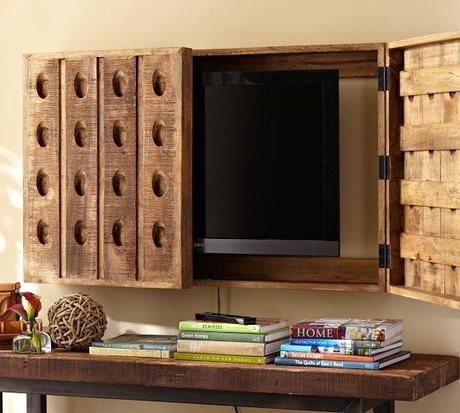 Riddling Rack Media Solution | Pottery Barn    Not crazy about the cover of this TV cover, but the photo shows basically how it is assembled.  Would prefer the covering to be artwork rather than the champagne bottle holders...