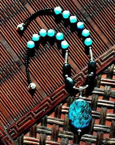Photo of beaded glass and stone pendant necklace