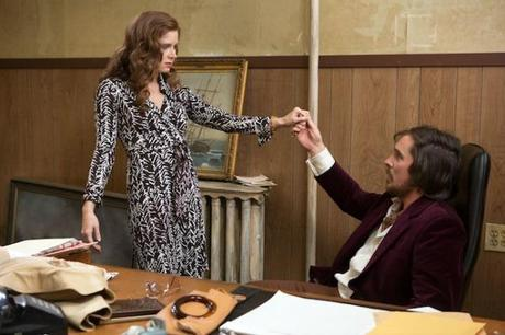 Amy Adams and Christian Bale star in Columbia Pictures' AMERICAN HUSTLE.
