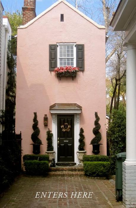 Charleston exterior in pink with swirling topiaries
