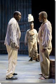 (L-R) James A. Williams (King Dick) and Dexter Zollicoffer (Deacon Simon) take part in a spirited conversation as Cedric Young (Governor, back) looks on.