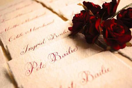 Autumn inspired wedding calligraphy in red with a natural texture