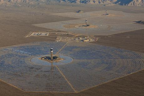An aerial view of the Ivanpah Solar Power Facility with left to right Tower 1, 2 and 3.