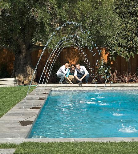 High-Tech Gadgets Create an Entertaining and Beautiful Swimming Pool Area