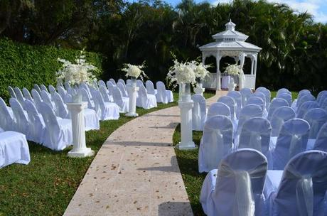 All white wedding aisle and altar decor