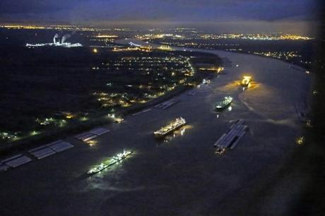 In this aerial photo, river traffic is halted along the Mississippi River between New Orleans and Vacherie, La., due to a barge leaking oil in St. James Parish, La., Sunday, Feb. 23, 2014. Credit: AP Photo/Gerald Herbert