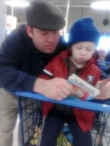 Practicing letter recognition in the grocery store checkout.