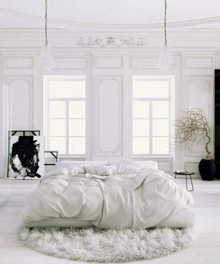 white-bed-in-middle-of-room