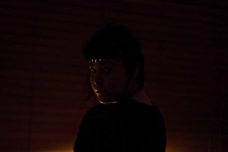figure in dark room
