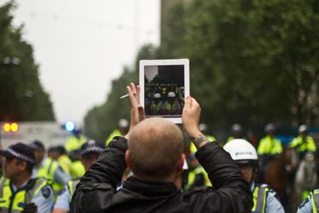 man filming with ipad at occupy melbourne rally
