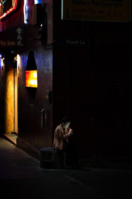 man smoking cigarette in laneway