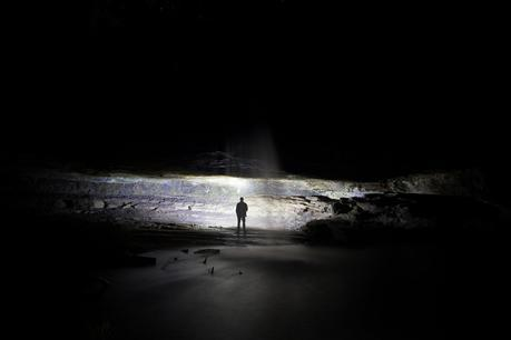 standing in lit cave night lower kalimna falls