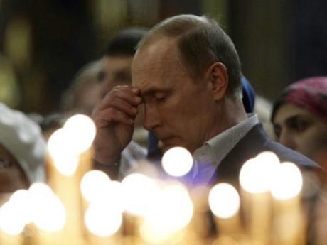 Putin praying