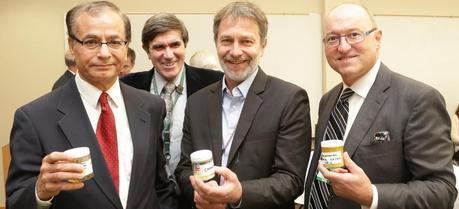 ORNL inventors (from left) Chaitanya Narula, Brian Davison and Martin Keller display the technology with Vertimass chairman William Shopoff.