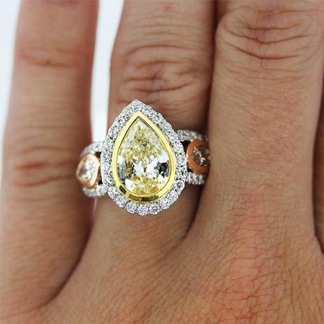 Pear shaped yellow diamond engagement ring