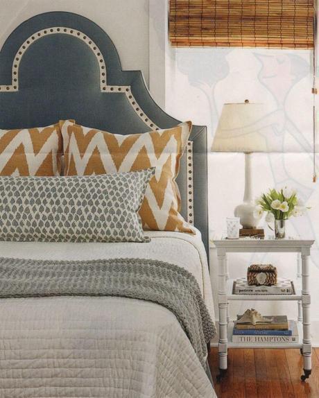 bedroom inspiration: dark gray upholstered headboard, white bedding, camel chevron pattern-