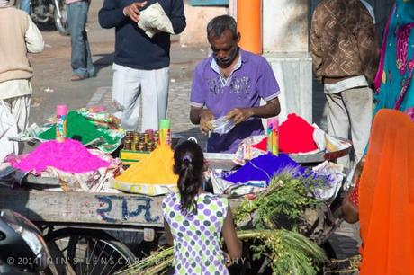 People in the market in Jaipur selling the color powder....