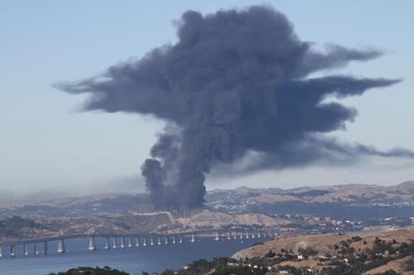 A fire at the Chevron oil refinery in Richmond, California, forced 15,000 people to seek medical attentiion. Photo courtesy of Ella Baker, Center for Human Rights.