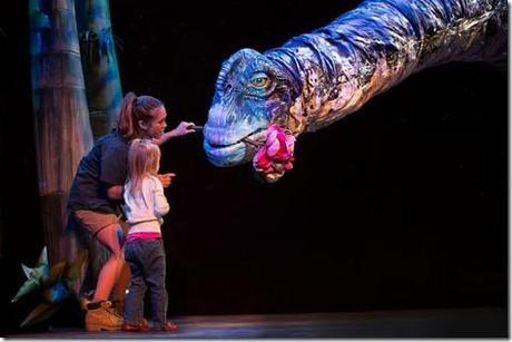 Aimee Louisanne with Titanosaur in Erths Dinosaur Zoo Live, Broadway in Chicago