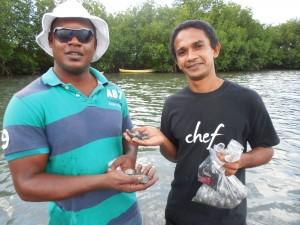Dion Harrigan (left) and Chef Desi Bahnan with cockles they found in saltwater lagoon near Hermitage Bay in Antigua
