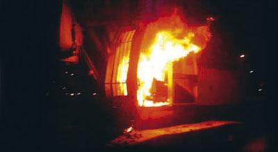 Photo of a burning excavator, April 2011.