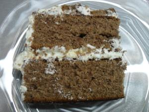 Chocolate Cake with White Frosting and Caramel-Almond chocolate Pieces