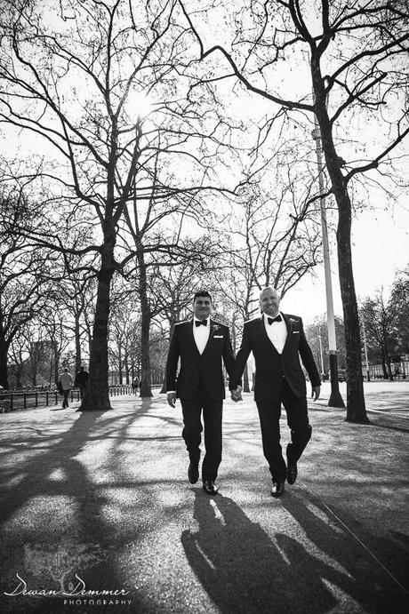 Grooms walk down Pall Mall on wedding day