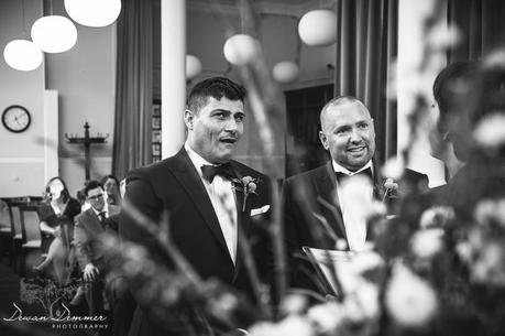 Groom makes a funny face during ceremony