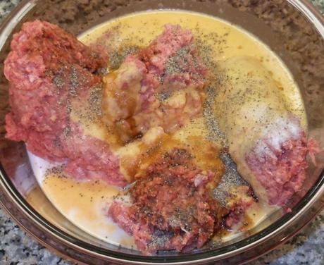 I added the reconstituted powdered eggs, fresh milk, salt, pepper, and soy sauce to my ground beef. Please note that I quadrupled this recipe, so this step-by-step will show a whole lot more meatballs than you will get out of one pound of ground meat.
