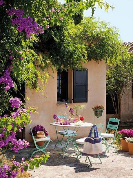 Mediterranean yard with bistro table and bougainvillea via El Mueble