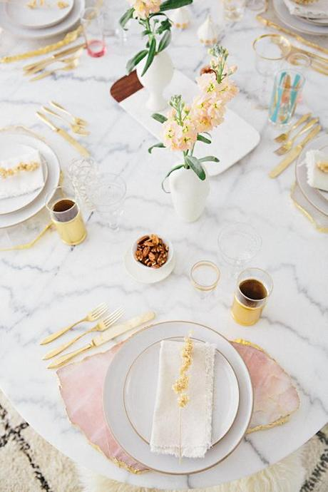 Gold And Blush Table Setting On Marble