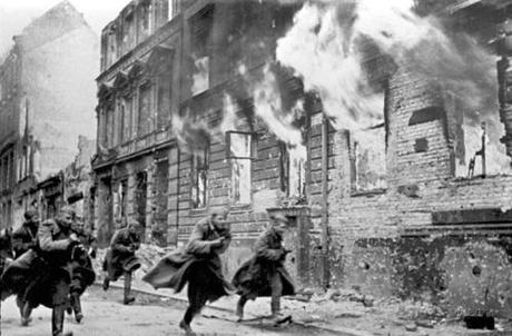 Incredible photo. Soviet soldiers race down a Berlin street in flames.