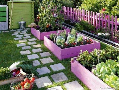 brightly painted garden fence and shed