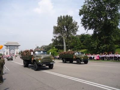 The army parade gets underway as locals line the avenue.
