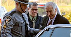 Jerry Sandusky, right, the former Penn State d...