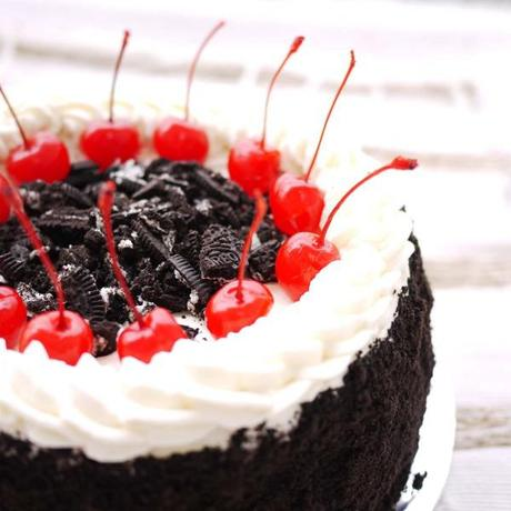 Oreo and Cherries on a Birthday Cake