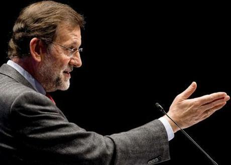 Mariano Rajoy and his People's Party storm to victory in Spain, financial woes remain