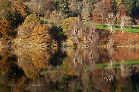 Landscape photo - autumnal reflections in Loch Yummel, Perthshire Scotland